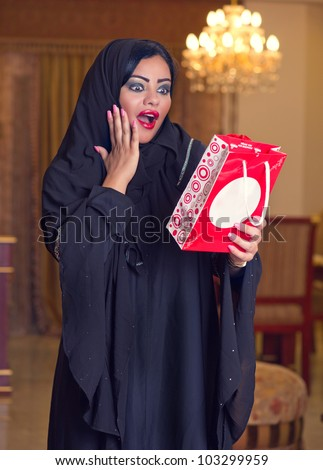 beautiful arabian lady happy for receiving a gift - stock photo