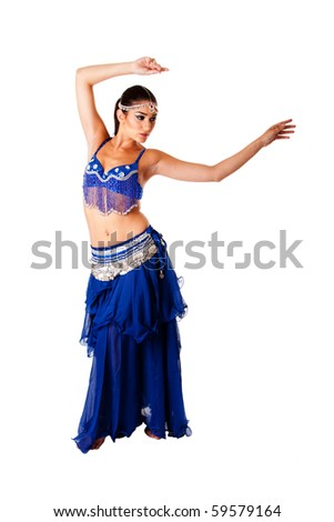 Beautiful Arabic belly dancer harem woman in blue with silver dress and head jewelry with gem dancing swirling her arms, isolated. - stock photo