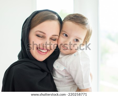 Beautiful Arabic family, mother and cute baby - stock photo