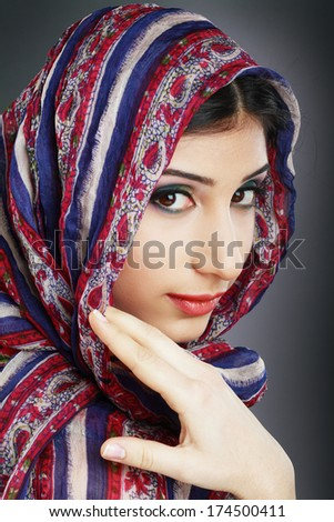 Beautiful Arabic woman wearing head scarf - stock photo