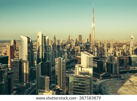 Beautiful architectural background. Panoramic view of Dubai's business bay at sunset. - stock photo