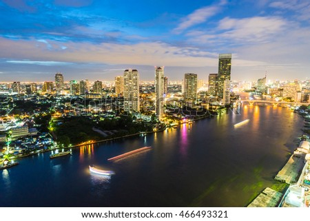 Beautiful architecture in bangkok city skyline at night around chao phraya river in Thailand