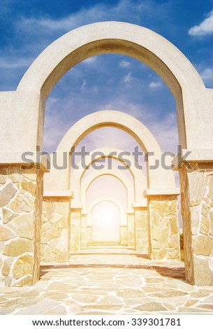 beautiful architecture, winding corridor with arch door decoration in the park - stock photo