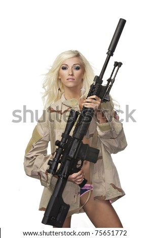 Beautiful armed blond woman wearing army camo flak jacket and lingerie holding massive heavy duty gun. - stock photo