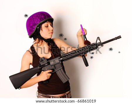 beautiful armed girl in pink protective cask with cosmetics brush - stock photo