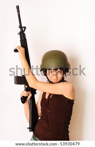Beautiful army girl holding gun. - stock photo