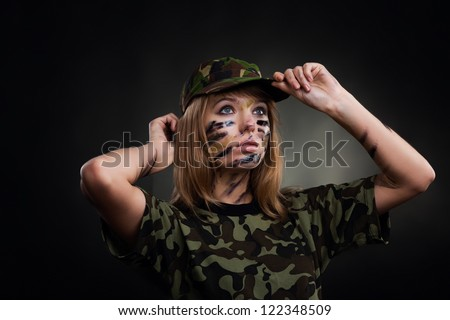 Beautiful army girl, soldier woman in t shirt military uniform over black background