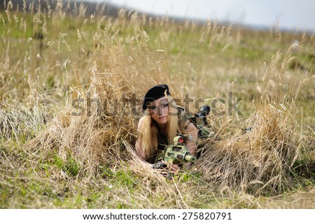 Beautiful army girl with gun  outdoor