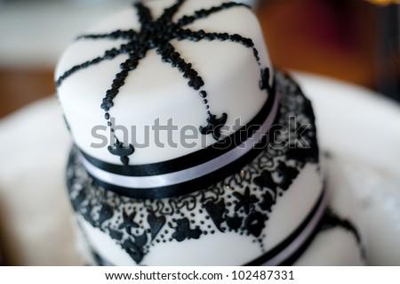 Beautiful art-deco 1920's style wedding cake - stock photo