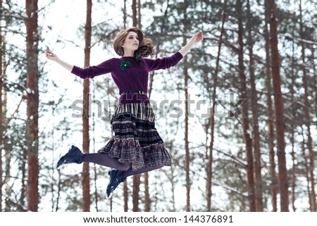 Beautiful art photo of a girl flying through the trees