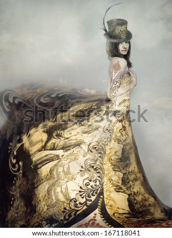 Beautiful artistic portrait of an extravagant lady in an eighteen century style dress and cylinder with clouds in the background - stock photo