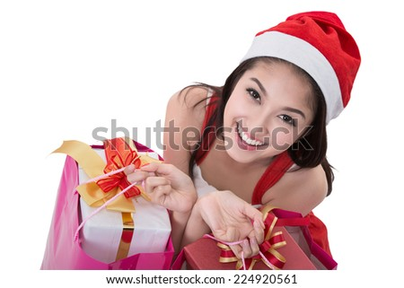 Beautiful Asia woman wear Santa Clause costume, christmas girl happy smile hold new year gift box present (clipping part for easy to use) - stock photo