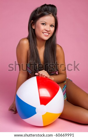 Beautiful asian beach ball girl - stock photo