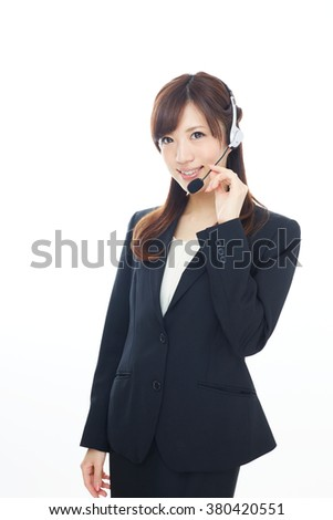Beautiful asian business operator isolated on white background - stock photo
