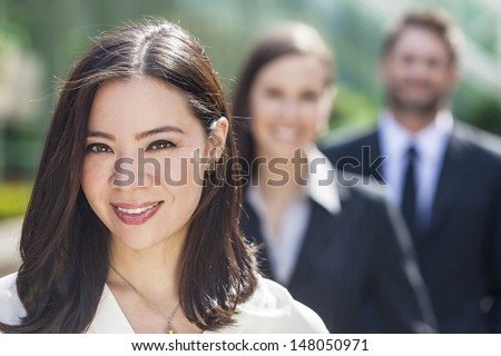 Beautiful Asian Business woman and interracial group of business men & women, businessmen and businesswomen team