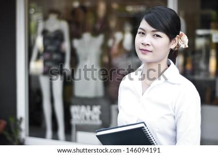 Beautiful Asian business woman in shopping mall. - stock photo
