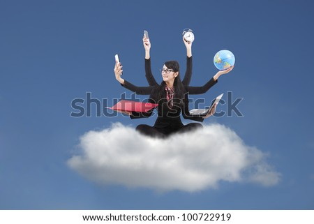 Beautiful asian business woman looking confident with six arms sitting on a cloud - stock photo