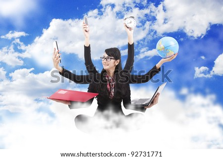 Beautiful asian business woman looking confident with six arms sitting on clouds - stock photo
