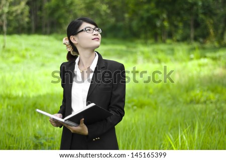 Beautiful Asian business woman, real estate investment. - stock photo