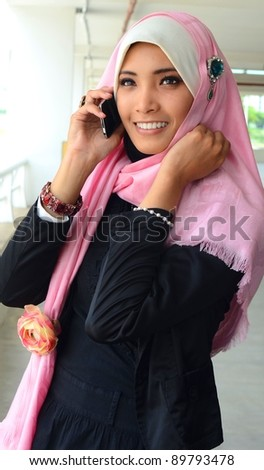 Beautiful asian business woman talking on cell phone