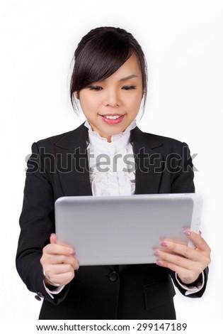 beautiful asian business woman using tablet computer - stock photo
