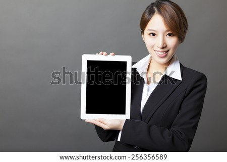 beautiful asian businesswoman showing tablet pc  - stock photo