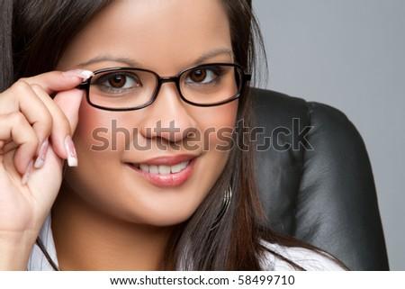 Beautiful asian businesswoman wearing glasses - stock photo