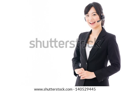 beautiful asian businesswoman with headset on white background - stock photo