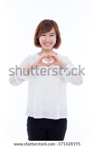 Beautiful Asian casual woman show heart shape isolated on white background.  - stock photo