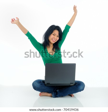 Beautiful Asian Female Student Sat On The Floor With A Laptop Computer