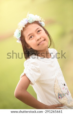 Beautiful asian girl at the farm looking smiling - stock photo