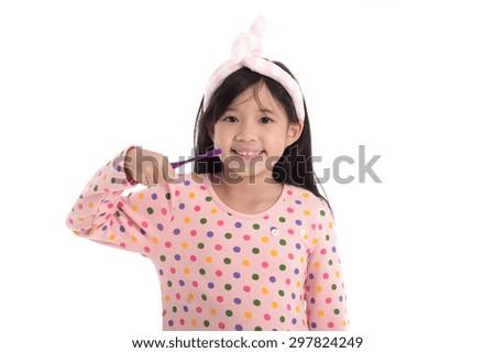 Beautiful asian girl brushing teeth on white background isolated - stock photo