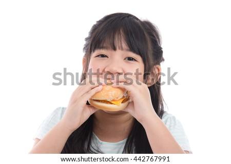 Beautiful asian girl eating hamburger on white background isolated - stock photo