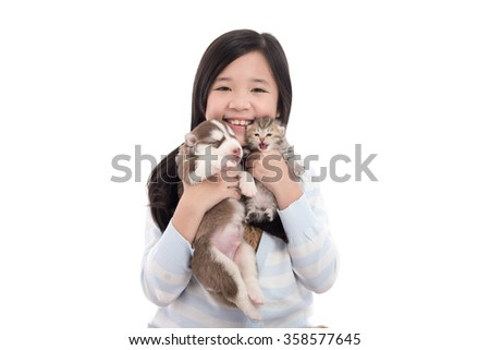 Beautiful asian girl holding newborn puppy and kitten on white background isolated - stock photo