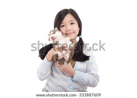 Beautiful asian girl holding newborn puppy on white background isolated - stock photo