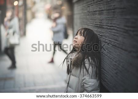 Beautiful asian girl looking up on street,Gion Kyoto Japan - stock photo
