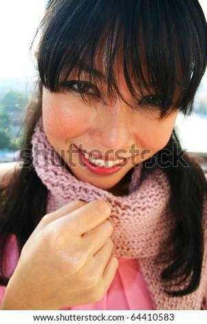 Beautiful asian girl outdoors wearing scarf. - stock photo