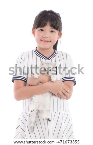 Beautiful Asian girl playing with lovely tabby kitten on white background,isolated