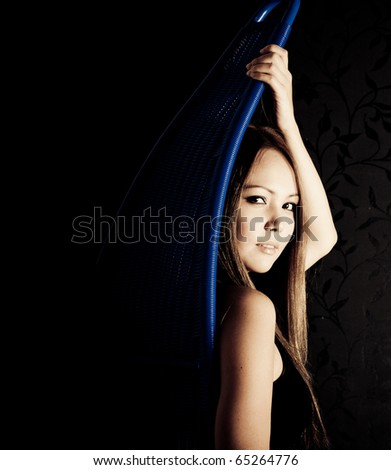 Beautiful asian girl portrait on black background - stock photo