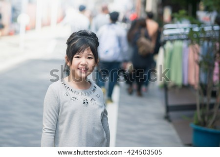 Beautiful Asian girl shopping in a street market,Tokyo Japan