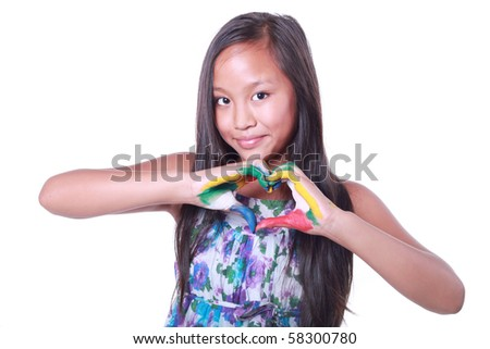 Beautiful asian girl showing a heart with her painted hands isolated - stock photo
