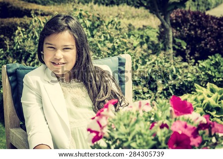 beautiful asian girl sitting in a park, vintage effect added - stock photo