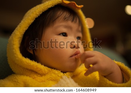 Beautiful Asian Girl Toddler in Yellow Duck Suit