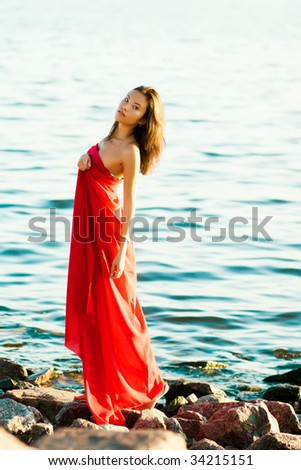 Beautiful asian girl with red scarf on seascape