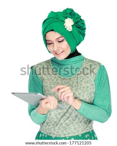 Beautiful asian girl with tablet computer isolated on white - stock photo