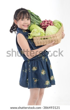 Beautiful Asian girl  with vegetables in basket, isolated on white background - stock photo