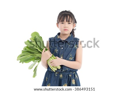 Beautiful Asian girl  with vegetables, isolated on white background - stock photo