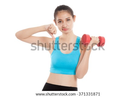 Beautiful Asian healthy girl thumbs down with dumbbell  isolated on white background - stock photo
