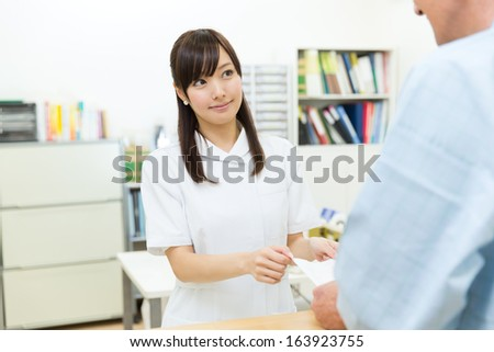 Beautiful asian hospital staff - stock photo