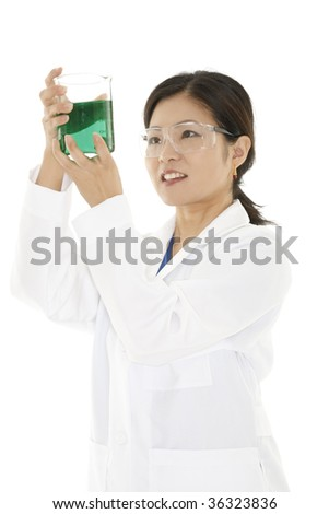 Beautiful Asian laboratory technician studying a beaker of liquid isolated on a white background